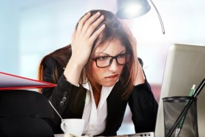 enterprise-content-management-overkill | Photo Courtesy of Depositphotos http://depositphotos.com/13604200/stock-photo-A-young-businesswoman-is-looking-stressed-as-she-works-at-her-computer.html?sst=200&sqc=496&sqm=696&sq=1z409l