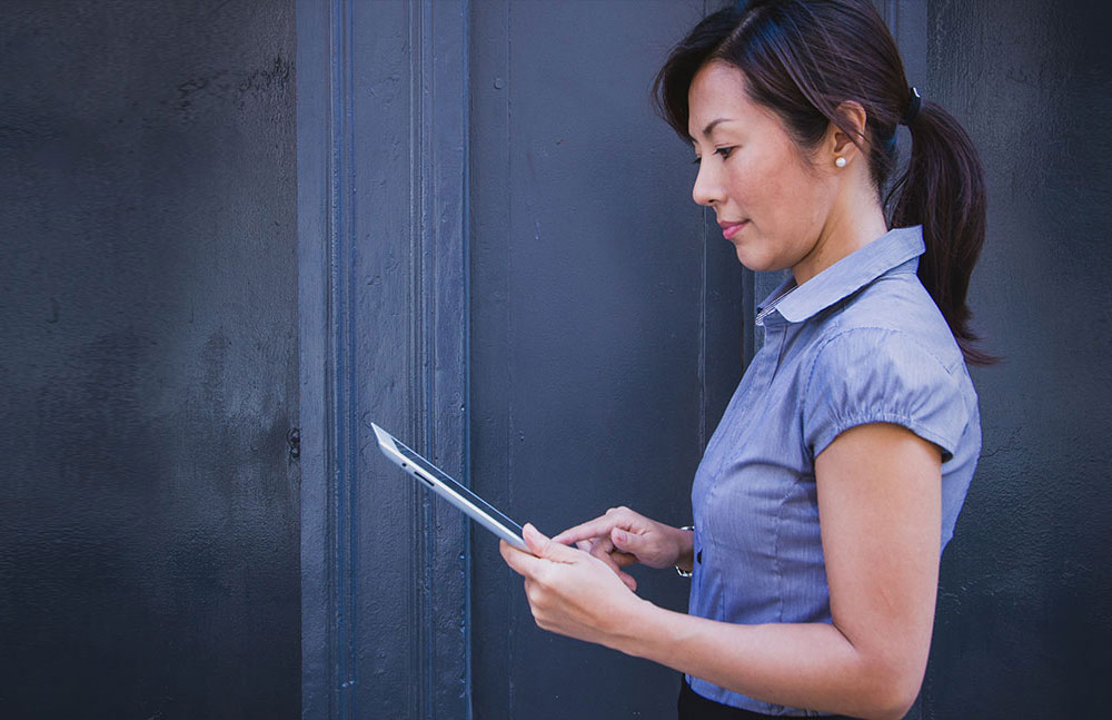 A woman looking at a tablet
