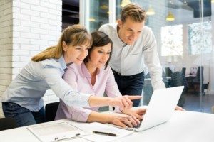 enterprise-collaboration-success | Photo Courtesy of ThinkStock http://www.thinkstockphotos.com/image/stock-photo-businessteam-presentation-on-laptop-in-office/466223211