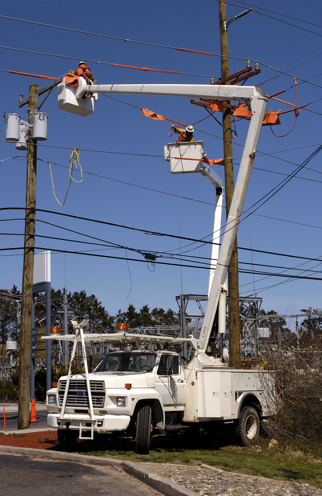 Utility field crew servicing distribution transformers.