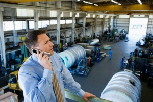 manufacturers-enterprise-tools | Photo Courtesy of ThinkStock http://www.thinkstockphotos.com/image/stock-photo-businessman-using-cell-phone-at-factory/78771483