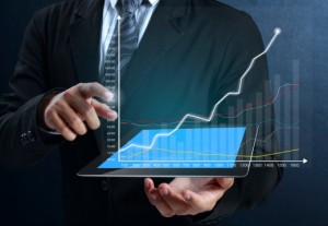 measuring-sharepoint-ROI | Photo Courtesy of ThinkStock http://www.thinkstockphotos.com/image/stock-photo-touch-screen-graph-on-tablet-in-hands/180442942