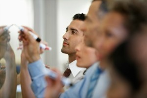 new-approach-collaboration | Photo Courtesy of ThinkStock http://www.thinkstockphotos.com/image/stock-photo-businesspeople-writing-on-whiteboard/78617832
