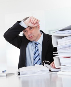 new-approach-records-management | Photo Courtesy of ThinkStock http://www.thinkstockphotos.com/image/stock-photo-exhausted-mature-businessman-at-work/186196005