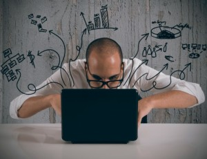 sharepoint-use-case | Photo Courtesy of ThinkStock http://www.thinkstockphotos.com/image/stock-photo-businessman-working-with-laptop/160368668